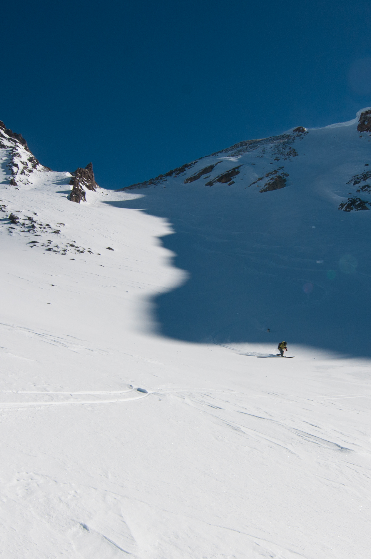 Rob skis the shadow line near Gros Peak